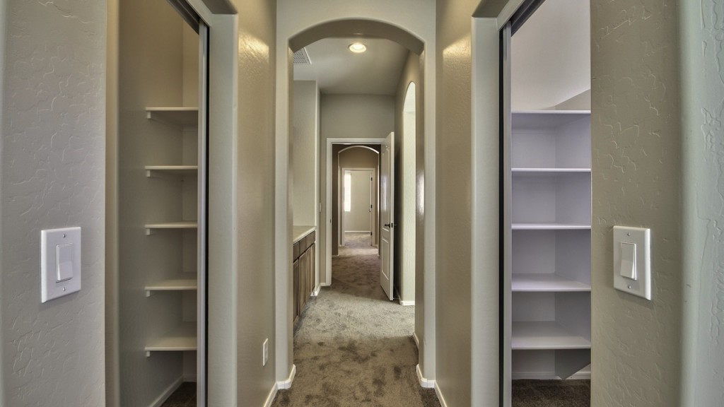 The Guerrero Group of Realty ONE 4142 E Vest Ave Master Retreat features his & her walk in closets