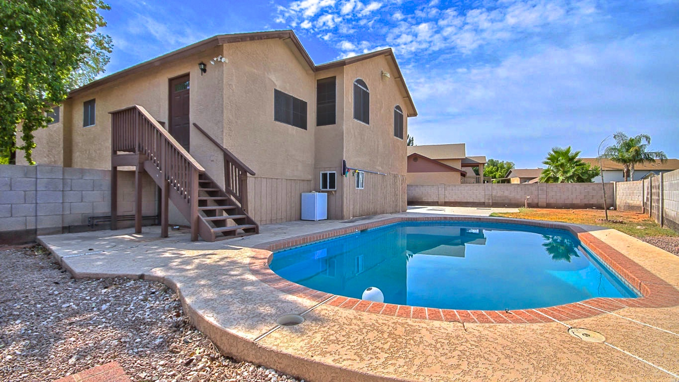 2 458 sf 4 bed 2 5 bath north gilbert home for sale with pool offering modernized interior and